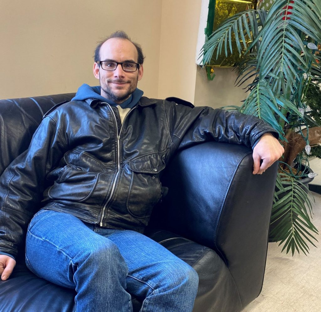 Ralph Erb sits on a couch in the Resource Centre for Supported Independent Living at  514 St. Mary Ave. New Directions, Winnipeg, Manitoba.